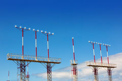 Landing lights towers in white and red Royalty Free Stock Photos