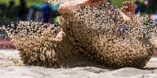 Landing in long jump in track and field royalty free stock photo