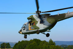 Landing military transport helicopter Royalty Free Stock Image