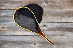 Landing net for fishing on rustic wood Stock Photography