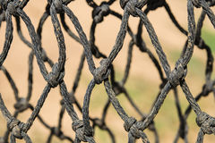 Landing net. Old fishing NET ropes, close to the surface Stock Photo