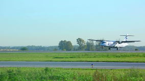 Landing. NOVOSIBIRSK, RUSSIA - SEPTEMBER 13, 2013: UTAir turboprop a late touch down. Spotting at airport Tolmachevo, Sep 13 2013, Novosibirsk, Russia stock video