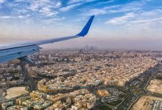 Landing of passenger aircraft in Dubai UAE, view of the city fro. M a flight altitude royalty free stock photos