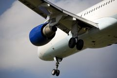 Landing passenger airplane Stock Photo