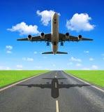 Landing passenger airplane Stock Photos