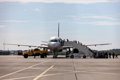 Landing of passengers aboard the plane at the airport. Stock Photo