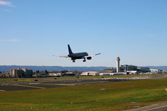 Landing at PDX, Portland Oregon. A commercial airline landing at PDX Portland international airport Royalty Free Stock Images