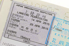 Landing Permission sticker with stamp on a passport in Japan. Closeup of the Landing Permission sticker with stamp on a passport for immigration traveling in Royalty Free Stock Image