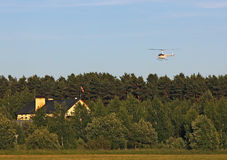 Landing personal helicopter near the country house Royalty Free Stock Photo