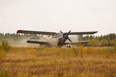Landing of the plane. The small plane sits down on crude air station. There are no roads overland stock photos