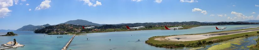 A landing plane at Corfu airport. Amazing Corfu airport captured with a landing plane. This airport has a runway in the sea! The photo was taken from Royal royalty free stock images