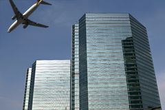 Landing plane flies over buildings royalty free stock photography