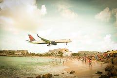 Landing plane in Sint Maarten, Philipsburg Royalty Free Stock Image