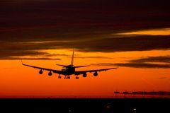 Landing plane on a sunset royalty free stock photos