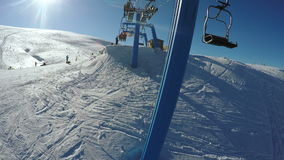 Landing from ski lift stock video footage