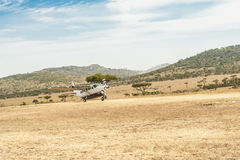 Landing of a small Plane in the Serengeti Stock Images