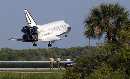 Landing Space Shuttle. A space shuttle landing at NASA's Kennedy Space Center Stock Photo