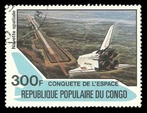 Landing Space shuttle. Congo - CIRCA 1981: Stamp printed by Congo, Multicolor memorable edition offset printing on the topic of Space exploration, shows Landing Stock Images