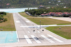 Landing at St. Barth airport. The island of Saint Bathelemy (St. Barth) is a French oversea collectivity on the Caribbean. The short airstrip is at the base of a Royalty Free Stock Images