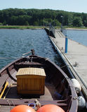 Landing stage 3. Rowing boat at a pier Royalty Free Stock Image
