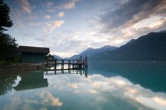 Landing stage. A landing stage at sunrise at Lake Annecy France Royalty Free Stock Image