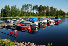 Landing stage with launches on forest lake. Stock Image