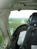 Landing Strip And Cockpit. Pilot landing at small strip in a tropical location stock photo