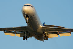 Landing at sunset. Jet airplane is approaching Rwy at sunset Stock Images