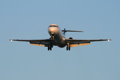 Landing at sunset. Jet airplane is approaching Rwy at sunset Stock Image