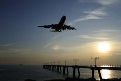 Landing & Sunset. Flying pass through Hong Kong airport repair station Royalty Free Stock Photo