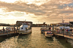 Landing of tourists on a boats is Venice, Italy Stock Photo