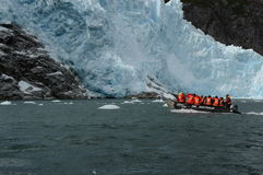 The landing of tourists from the cruise ship to the glacier Nena. Stock Photo