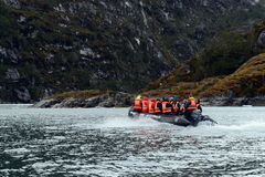 The landing of tourists from the cruise ship to the glacier Nena. Royalty Free Stock Photo
