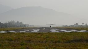 Landing of ultralight. Ultralight landing on the runway at the airport stock footage