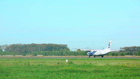 Landing. UTAir turboprop a late touch down. Spotting at airport Tolmachevo stock video