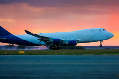 Landing widebody cargo aircraft. Early summer morning stock images