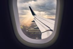 Airplane in the windstorm. Landing during wind storm. View from the airplane window Stock Photos