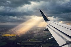 Airplane in the windstorm. Landing during wind storm. View from the airplane window on the dramatic sky Stock Images