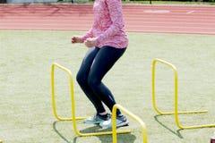 Landing between yellow hurdles Stock Image