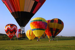 Landing Zone. A hot air balloon comes in for a landing during a festival in Iowa royalty free stock images