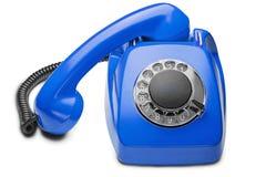 Landline blauwe telefoon op een geïsoleerde witte achtergrond Royalty-vrije Stock Foto's
