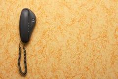 Landline phone hanging on the wall Stock Photo