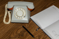 Landline phone with a notebook Royalty Free Stock Photo