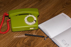 Landline phone with a notebook Royalty Free Stock Photos