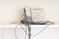 Landline telephone covered in white paint Stock Images