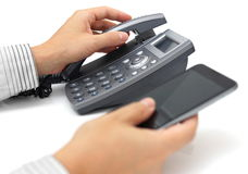 Landline telephone and mobile phone support. An landline telephone and mobile phone support Stock Photos