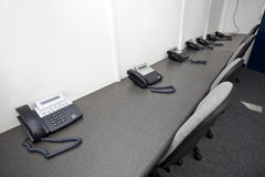 Landline telephones and chairs in television station Royalty Free Stock Photography