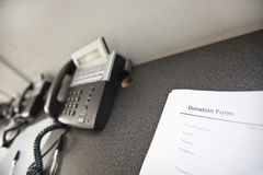 Landline telephones and document on table in office Royalty Free Stock Photo