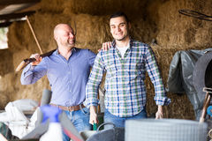 Landlords working in a barn Stock Photography