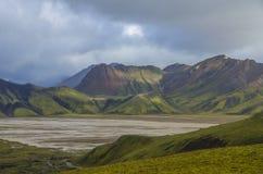 Landmannalaugar. Iceland. Lake and moss-covered volcanic mountains. Landmannalaugar. Iceland Royalty Free Stock Photography